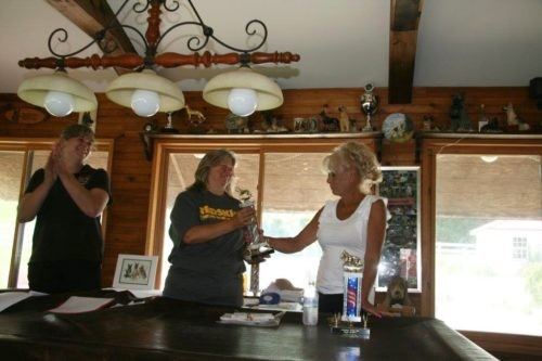 Awards at the club. Kathy with her Schutzhund 2 with her female Issa that she got as a puppy at Misty Ridge.